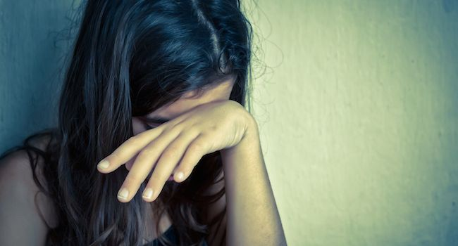 Image of a young woman upset